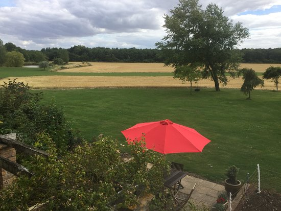 Weldon, UK: View of patio and across field to woodland