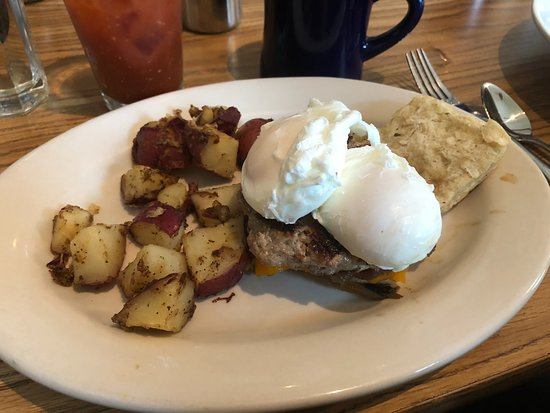 Greenfield, NH: Poached eggs on a homemade biscuit with a homemade sausage and Vermont cheddar cheese