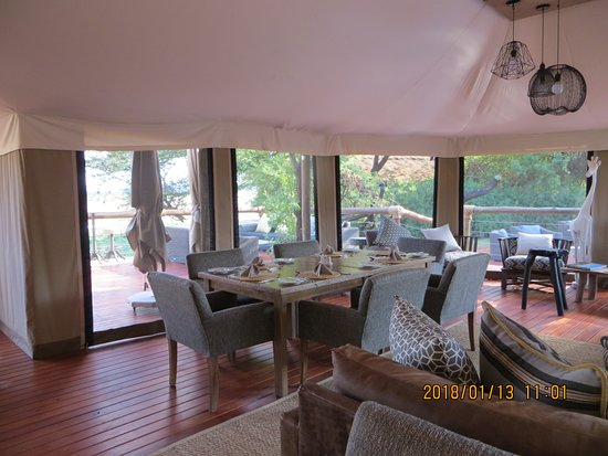 Tau Game Lodge: This is the canvased-roofed dining room and patio overlooking the watering hole.