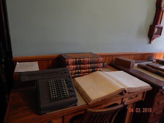 Santa Paula, CA: Old adding machine and ledger book at the pay window