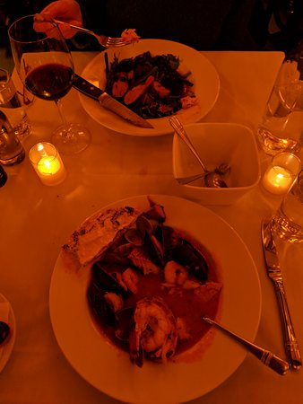 Wild Fig : Mixed seafood stew and duck breast entress. It's a bit dim in the dining room!