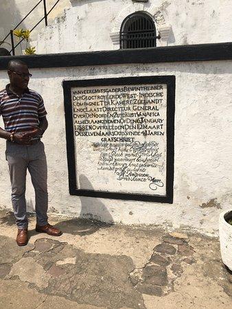 Elmina Castle: Tour guide explaining sign
