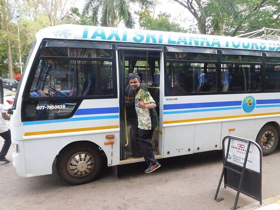 Cheap Bus Tours : Our minibus and guide Prasana