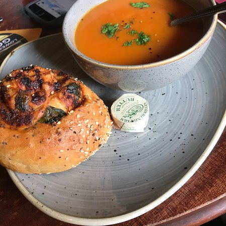 Loweswater, UK: Spicy pepper and sweet potato soup with crusty herb roll and butter - hmmm very yummy.
