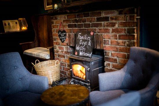Denton, UK: Our cosy snug by the log burner