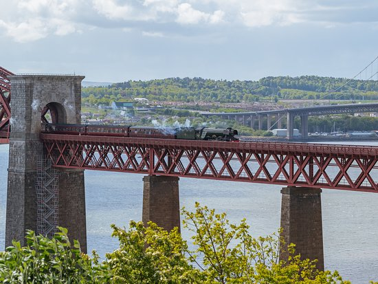 The Flying Scotsman crosses the Forth Bridge to South Queensferry. © VisitScotland / Tony Marsh