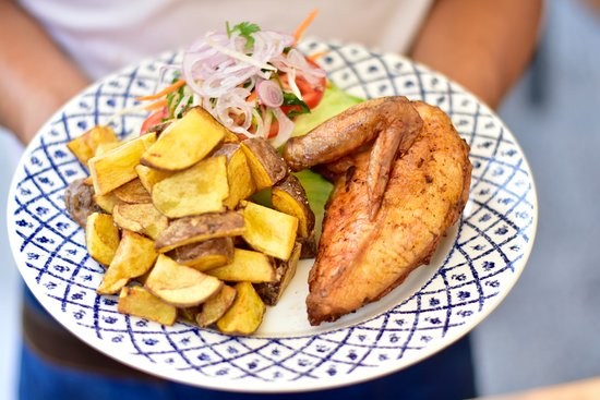 Lima Region, Peru: pollo ala leña con papas nativas 100% peruanas y ensalada fresca