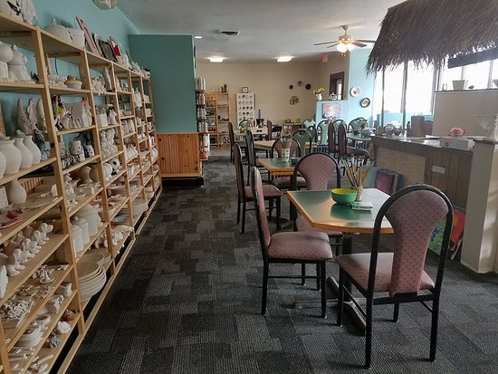Laconia, NH: Ceramic room with customer seating.  Tiki Hut!!