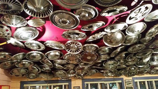 Chuys: Ceiling in one of the dining rooms, hub caps
