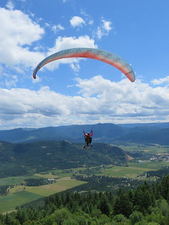 Lumby, Canada: A paragliding tandem at the Freedom Flight Park