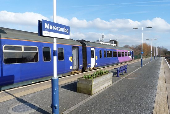 A local service train to Lancaster waits departure from Morecambe railway station.