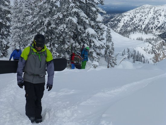 Grand Targhee Ski Resort: Looking back down with some guys from our group contemplating dropping in on the back side.