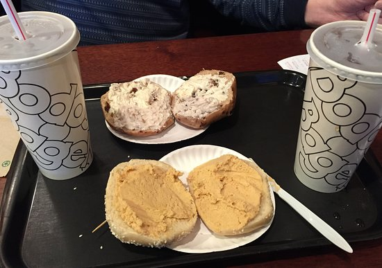 Bodo's Bagels - 1 with hummus. 1 with cream cheese
