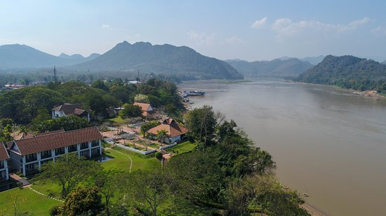 The Grand Luang Prabang Hotel & Resort: Areal view of our garden and prime location in front of the Mekong river