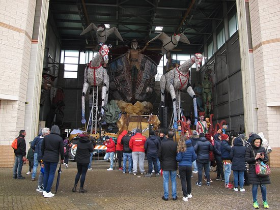 Cittadella del Carnevale: With hanger doors open, viewers can peek at the parked floats