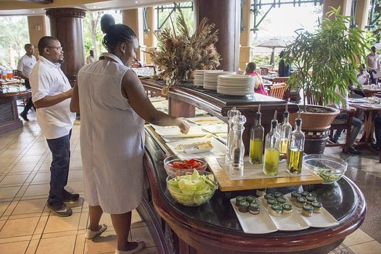 a island with a choice of cheeses and cold meats