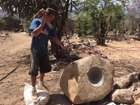 Managua, Nicaragua: Preparing a boulder for the stone grinding mill