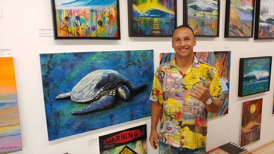 "Kahuku, HI: Hilton Alves with his stunning art work in the ""Art Box Gallery"""