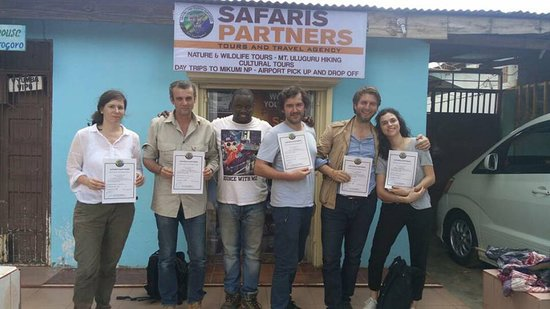 our happy clients with their certificate at our office in Morogoro