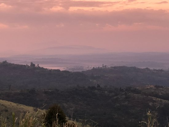 Национальный парк Кибале, Уганда: View of the sunrise over Kibale Forest from the lodge.