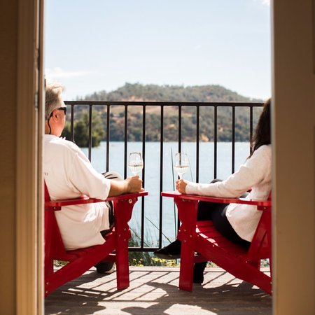 Clear Lake Cottages & Marina: Relaxing with a glass of wine on the deck of Cottage #27.