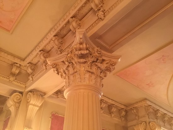a3f366d2100 Moss Mansion  Artistic work at the tops of the pillars in the ballroom. The