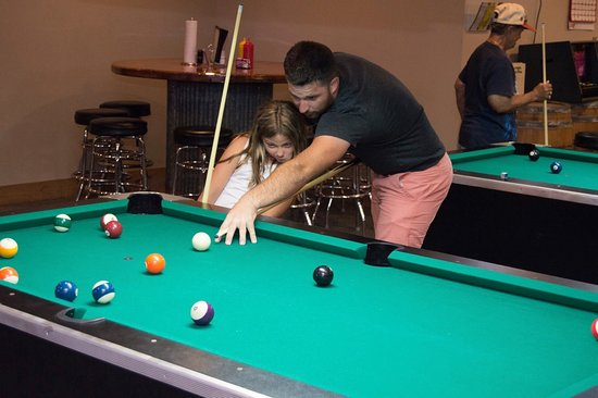 Bourbon, MO: Levi teaching Adalynn the fine art of playing pool :)