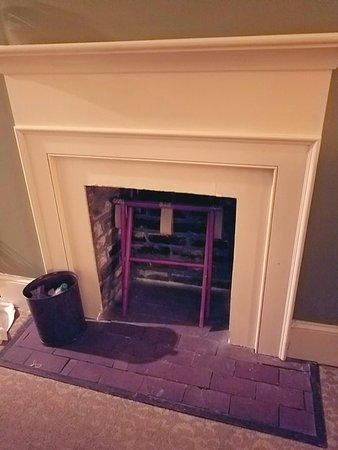 River Street Inn: The fireplace with loose flooring