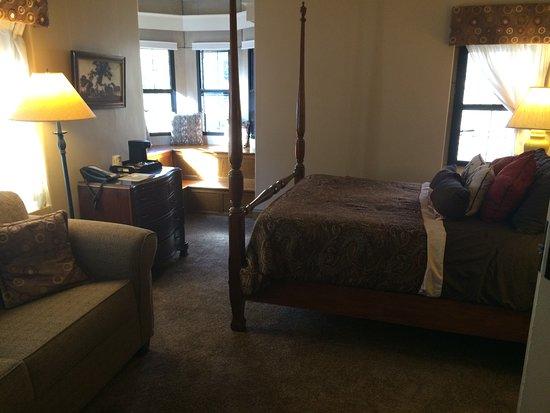 Glen Eyrie Castle & Conference Center: Castle room bedroom, with corner seating area.