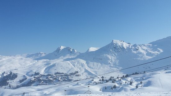 blue skies snowy mountains picture of la plagne ski resort macot