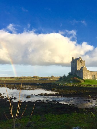 Kinvara, Ireland: Dungaire Castle with a rainbow captured.