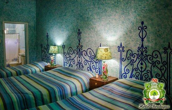 San Marcos, Nicarágua: hotel boutique y restaurante hacienda san pedro.com habitacion con 3 camas