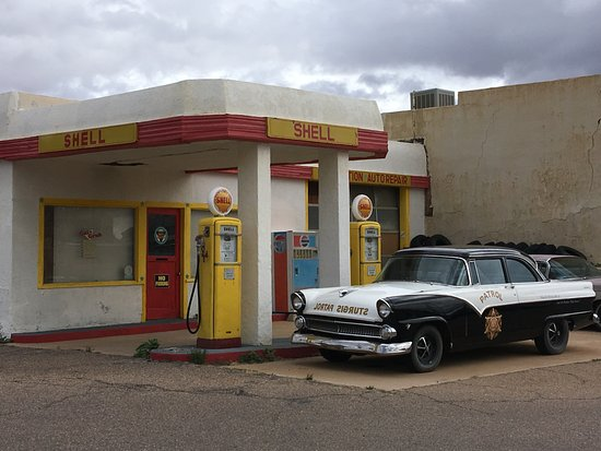 Old Shell gas station and vintage police car - Picture of Erie