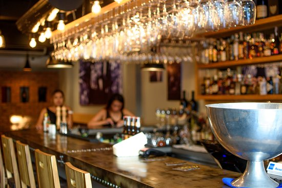 The unique bar counter is made from Volcanic steel. - Picture of The ...