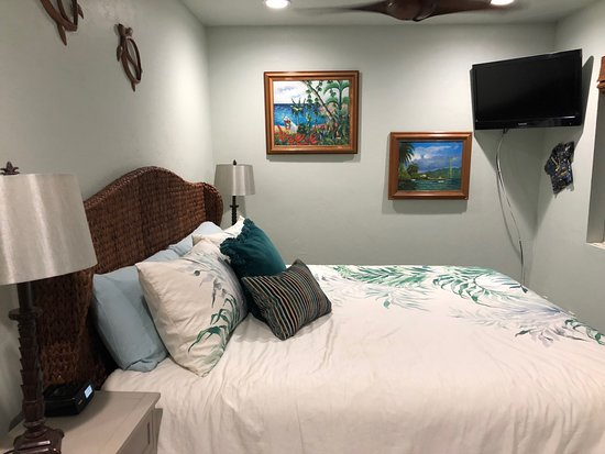 Kihei Kai Oceanfront Condos: spacious king sized bed with tv and fan in room #24