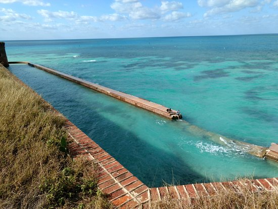 Key West Seaplane Adventures : Sitting on the sea wall