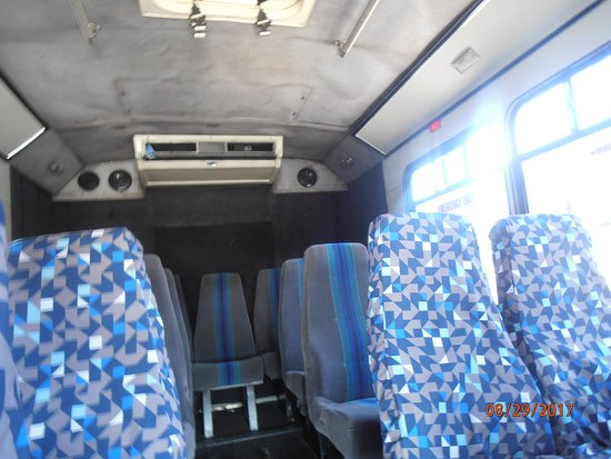 Inside of the shuttle bus that picks you up in front of the