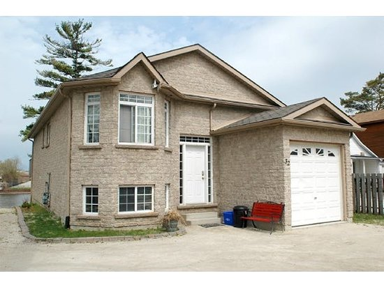 Wasaga River Resort Inc: stonecrafted vaction home gated and waterfront
