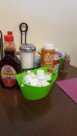 Chat - N - Chew Cafe: Condiments conveniently placed on the table.