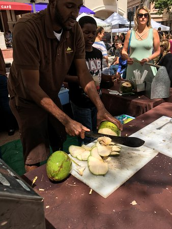 West Palm Beach Green Market: Cutting fresh coconuts for water