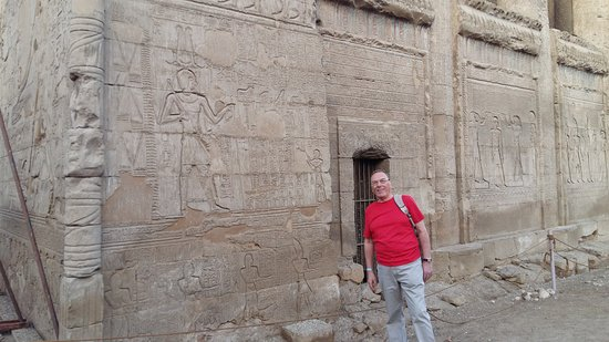 Isna, Egypt: outside the temple showing carvings on the wall