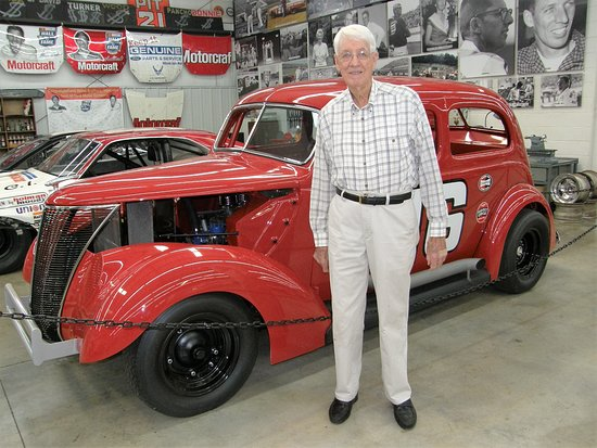 """Stuart, VA: Glen Wood stands in front of his # 16 Ford, nicknamed """"The Woodchopper."""""""