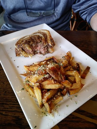 Meehan's Irish Pub: half eaten sandwich, delish! tasty fries