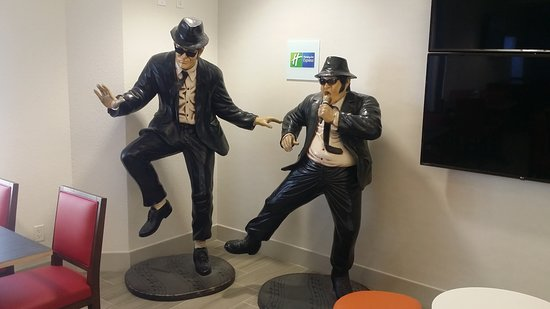 Holiday Inn Express Hotel & Suites Universal Studios Orlando: The Blues Brothers in the breakfast area. They can use a dusting.