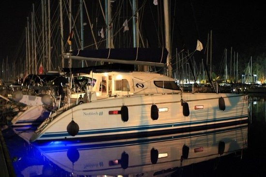 Galaxidi, Greece: RED FOX Catamaran by night with under-water light