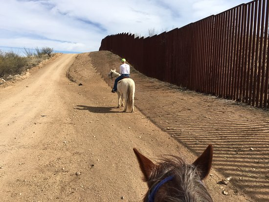 Sasabe, AZ: The US-Mexico border wall is adjacent to the ranch property.
