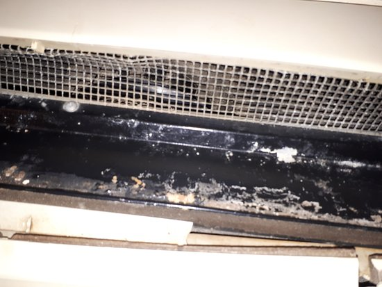 Red Roof Inn Farmington Hills : Mold on the wall fan unit and missing cover. Disgusting