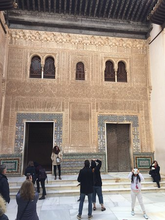 Alhambra : Muslim wall with Arabic inscriptions and amazing detailed carving