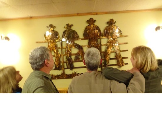 "Show Low, AZ: ""Four Cowboys on a Rail Fence"" is one of the many very well done metal art pieces in Cattlemen's"
