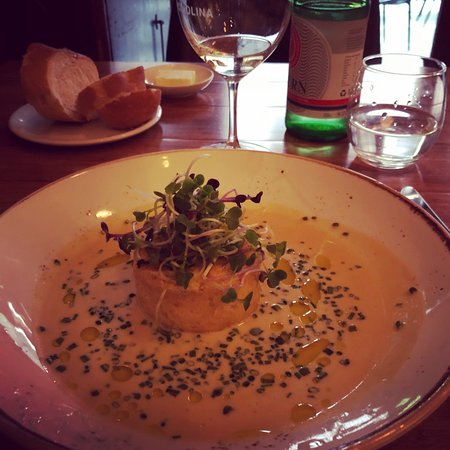 Cicciolina: Soufflé of blue swimmer crab meat, shallot and lemon thyme served with a champagne and chive vel